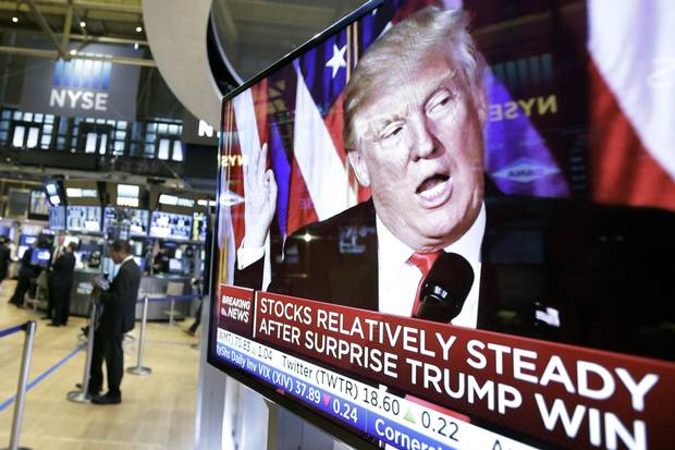 An image of president-elect Donald Trump appears on a television screen on the floor of the New York Stock Exchange on Nov. 9, 2016.