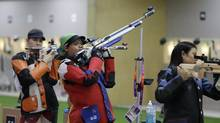Malaysian Olympic athlete Nur Suryani Mohamed Taibi, who is eight months pregnant, shoots during a training session in London on July 27, 2012. (Rebecca Blackwell/AP)