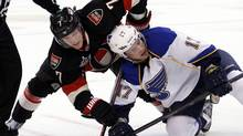 Ottawa Senator Kyle Turris leans on St. Louis Blue Vladimir Sobotka in Ottawa Feb. 7, 2012. (Blair Gable/Reuters/Blair Gable/Reuters)