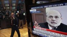 In a Feb. 2 file photo Federal Reserve Chairman Ben Bernanke's testimony before the House Budget Committee is visible on a television screen on the floor of the New York Stock Exchange (Richard Drew/AP)