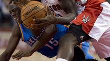 Toronto Raptors forward Quincy Acy battles for a loose ball with Oklahoma City Thunder guard Reggie Jackson on Sunday. (Frank Gunn/THE CANADIAN PRESS)