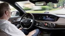 A Mercedes-Benz S 500 with Intelligent Drive rides autonomously through country roads and inner-city traffic. (Mercedes-Benz)