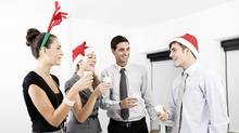 Companies scaling down holiday parties (iStockphoto)
