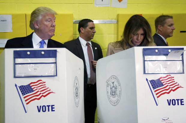 Donald Trump and his wife, Melania, vote at PS 59 in New York.