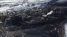 Suncor Oil Sands operation, near where officials were seen taking samples for the Athabasca River, following a pipeline carrying industrial waste water ruptured, Tuesday, March, 26, 2013 in Fort McMurray, Alberta. (Brett Gundlock for The Globe and Mail)