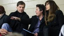 Alexei Yashin talks with team mentor Shannon Miller as Carol Alt listens in during a Team Russia game. (Mike Carroccetto for Globe and Mail)