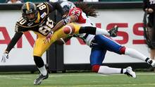 Montreal Alouettes Dwight Anderson breaks up a pass intended for Hamilton Tiger-Cats wideout Chris Williams in the end zone during first-half Canadian Football League action in Hamilton, Ontario, Monday, Sept. 5, 2011. (The Canadian Press)