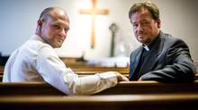 The Rev. Frank Schaefer, right, and his son Tim, at Foundry United Methodist Church in Washington, June 30, 2014. Frank endangered his own career as a minister by officiating Tim's same-sex wedding, a defiance of church orthodoxy that led to a church trial, defrocking and, now, reinstatement. After it all, the Schaefers are recommitting to their relationship with the United Methodist Church. (GABRIELLA DEMCZUK/NYT)