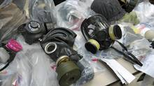 A collection of gas masks seized from G20 summit protesters are displayed during a news conference at Toronto police headquarters on June 29, 2010. (Fred Lum/The Globe and Mail)