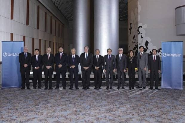 Trade ministers from a dozen Pacific nations are shown in Atlanta on Oct. 1, 2015.