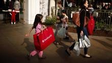 People shop at The Grove mall in Los Angeles in this November 26, 2013 file photo. (LUCY NICHOLSON/REUTERS)