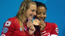 Canada's Emilie Heymans and Jennifer Abel celebrate their bronze medals following the women's synchronized 3-metre springboard final at the Aquatic Centre at the 2012 Summer Olympics in London on Sunday, July 29, 2012. (CP)