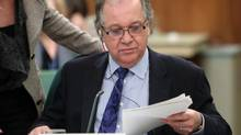 Aboriginal Affairs Minister Bernard Valcourt prepares to take part in a Commons Aboriginal Affairs committee in Ottawa, on Parliament Hill, Thursday May 29, 2014. (FRED CHARTRAND/THE CANADIAN PRESS)