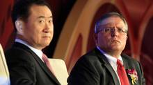 Gerry Lopez, right, CEO of AMC Entertainment, listens to a question next to Wang Jianlin, president of Wanda Group, during a media conference in Beijing on Monday, May 21, 2012. Wanda Group, one of China's largest theatre owners, has agreed to buy AMC Entertainment in a deal valued at $2.6-billion, creating the world's biggest cinema operator, the companies said. (DAVID GRAY/DAVID GRAY/REUTERS)