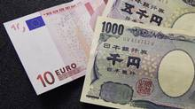 A 10 euro note is spread out next to Japanese yen notes at a Bureau de Change in Brussels. (FRANÇOIS LENOIR/REUTERS)