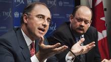 LSE CEO Xavier Rolet, left, and TMX Group CEO Tom Kloet speak to reporters in Toronto Feb. 9. 2011 (MARK BLINCH)