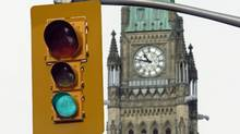 Traffic gets a green light near the Peace Tower ahead of the resumption of Parliament on Wednesday March 3, 2010. (Adrian Wyld)