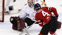 Team Canada's Taylor Hall goes up to score past Team Switzerland goaltender Benjamin Conz during second period semifinal action at the world junior hockey championship Sunday, Jan 3, 2010 in Saskatoon, Sask.. THE CANADIAN PRESS/Nathan Denette (Nathan Denette)