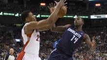 Toronto Raptors' Rudy Gay (left) is fouled by Charlotte Bobcats Michael Kidd-Gilchrist during first half NBA basketball action in Toronto on Friday March 15 , 2013. (Chris Young/THE CANADIAN PRESS)
