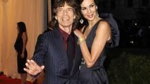 This May 7, 2012 file photo shows singer Mick Jagger, left, and L'Wren Scott at the Metropolitan Museum of Art Costume Institute gala benefit. (Evan Agostini/AP)