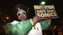 Kris Brannon of Tacoma, Washington, a fan of former NBA franchise the Seattle Supersonics, holds up a 'Save our Sonics' memorabilia sign during a campaign rally for Republican presidential candidate Rick Santorum in Tacoma in this photo taken February 13, 2012. City of Seattle officials said February 15 that an announcement will be made on February 16 about a possible basketball arena deal that may bring back an NBA team to Seattle. Picture taken February 13, 2012. (ANTHONY BOLANTE/REUTERS)