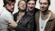Marcus Mumford, right, with his three 'sons.' Mumford and Sons from left Winston Marshall, Ted Dwane, Ben Lovett and Marcus Mumford, are photographed in Toronto Sep 18, 2012. (Moe Doiron/The Globe and Mail) (Moe Doiron/The Globe and Mail)