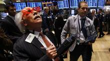 "Trader Peter Tuchman of Quattro M Securities Inc. wears ""2012"" glasses as he works on the main trading floor of the New York Stock Exchange during the final trading day of 2011 in New York December 30, 2011. (REUTERS/Mike Segar/REUTERS/Mike Segar)"