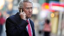 Former Chief Executive Officer, Chairman, and Co-founder of Chesapeake Energy Corporation Aubrey McClendon talks on his mobile phone as he walks through the French Quarter in New Orleans, Louisiana in this March 26, 2012 file photo. (Sean Gardner/Reuters)