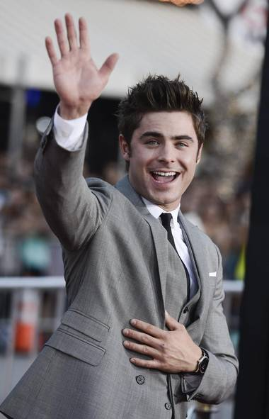 "What? Me worry? Elfin ex-Disney star Zac Efron was on top of the world at the L.A. premiere of his new film Neighbors. Here we see ""Happy Zac."" (Dan Steinberg/Associated Press)"