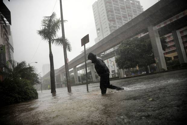 Miami, Sept. 10: A local resident walks across a flooded street.
