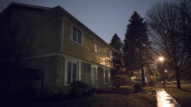 A streetlight illumines a vacant house in southeast Oakville. Local resident suspect suspect speculators, likely foreign, are behind a trend of homes selling and then sitting empty.