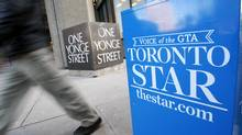 A pedestrian walks past a Toronto Star newspaper box in front of the Toronto Star building at One Yonge Street in Toronto. (REUTERS/Mark Blinch/REUTERS/Mark Blinch)