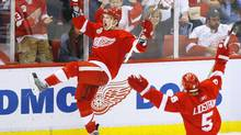 Detroit Red Wings forward Justin Abdelkader celebrates his goal with teammate Nicklas Lidstrom during the third period in Game 2 of the Stanley Cup final against the Pittsburgh Penguins in Detroit on Sunday. (REBECCA COOK)