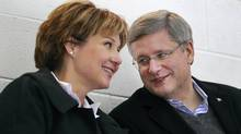 Canadian Prime Minister Stephen Harper and B.C. Premier Christy Clark look on as Clark's 10-year-old son Hamish plays during a minor league hockey game in Vancouver, Thursday January 12, 2012. (Handout/Handout)