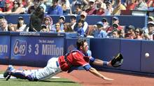 Toronto Blue Jays catcher J.P. Arencibia dives for and misses a foul ball hit by Los Angeles Angels of Anaheim batter Torii Hunter during the first inning. (MIKE CASSESE/REUTERS)