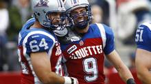 Montreal Alouettes' Eric Deslauriers (9) celebrates his touchdown with teammate Ryan Bomben (64) during their CFL game against the Edmonton Eskimos in Montreal October 28, 2012. (OLIVIER JEAN/REUTERS)