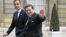 Bank of Canada Mark Carney, left, and Finance Minister Jim Flaherty arrive for a meeting at the Elysee Palace in Paris on Thursday (FRED DUFOUR/AFP/Getty Images)