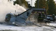 Firefighters attend the scene of a plane crash in Richmond, B.C. on Thursday Oct. 27, 2011. (Steve Smith/ The Canadian Press/Steve Smith/ The Canadian Press)