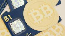 Bitbills, a physical representation of the virtual currency Bitcoin, shown in Amherst, Mass. (NANCY PALMEIRI/NYT)