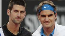 Serbia's Novak Djokovic, left, and Switzerland's Roger Federer pose for a picture prior to the start of a semifinal match at the Italian Open tennis tournament, in Rome, Saturday, May 19, 2012. (AP Photo/Gregorio Borgia) (Gregorio Borgia/AP)