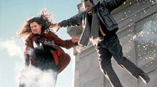 Geena Davis fires her machine gun to blow a hole in the ice below as she and Samuel L. Jackson jump from a building into a lake to escape the bad guys. (handout/CP)