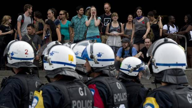 The riot squad stands by as student block an entrance to the Universite de Montreal Monday, August 27, 2012 in Montreal.