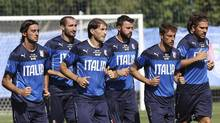 Italy's soccer players, from left, Alberto Aquilani, Giorgio Chiellini, Gabriel Paletta, Andrea Barzagli, Claudio Marchisio and Alessio Cerci train for the World Cup in Mangaratiba, Brazil, Thursday, June 12, 2014. Italy plays in group D at the World Cup. (Antonio Calanni/AP Photo)
