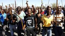 Mine workers take part in a march at Lonmin's Marikana mine in South Africa on Sept. 10, 2012. (SIPHIWE SIBEKO/REUTERS)