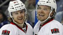 Ottawa Senators' Milan Michalek (R) celebrates a goal with teammate Erik Karlsson during the third period of an NHL hockey game against Tampa Bay Lightning in Tampa, Florida March 6, 2012. The Senators face the Newe York Rangers in the first round of the NHL playoffs. REUTERS/Mike Carlson (Mike Carlson/Reuters)