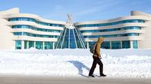 A students walks by the Regina campus of the First Nations University of Canada in Regina in January. (Troy Fleece For The Globe and Mail)