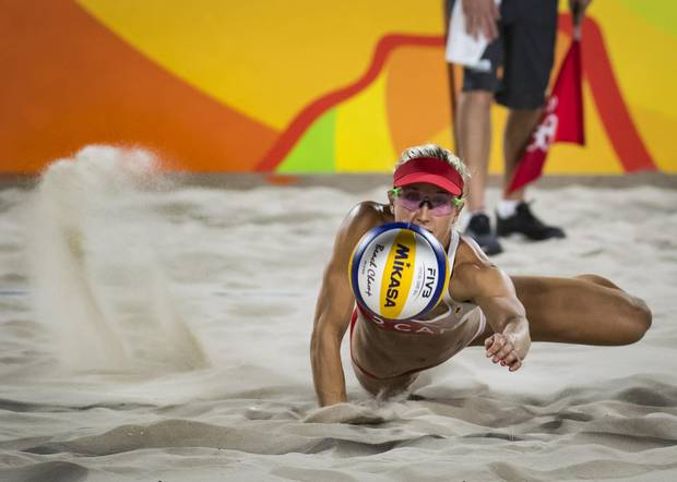 Canadian Heather Bansley in action during her preliminary beach volleyball match against team Swiss at Rio Olympics August 10, 2016. (John Lehmann/The Globe and Mail)