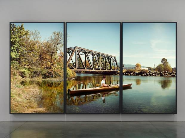 Rodney Graham's lightbox triptych Paddler, Mouth of the Seymour, 2012-13 serves as a sort of centrepiece for the exhibition and is visible from the VAG's rotunda.