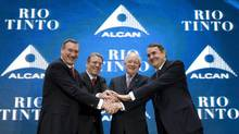 From left to right: Dick Evans, president and chief executive officer of Alcan Inc., Tom Albanese, chief executive of Rio Tinto, Yves Fortier, chairman of Alcan Inc., and Paul Skinner, chairman of Rio Tinto shake hands during a meeting with employees in Montreal, in this July 12, 2007, file photo. (Christinne Muschi/Reuters)