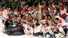 The Montreal Canadiens pose for a photograph with the Stanley Cup following their 4-1 victory over the Los Angeles Kings in Montreal in this June 9, 1993 file photo. (Frank Gunn/CP)